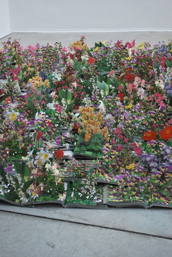 Artist Thomas Allen created a bed of flowers from a collection of gardening books.