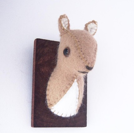 For something small scale, this Taupe Fawn ($25) is only a little over two inches tall and handstitched from wool felt.