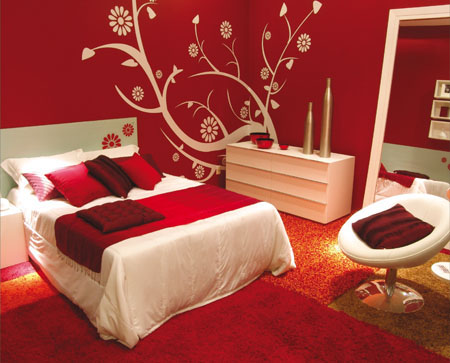 To modernize red rooms, choose a red that has no brown tones for the wall color. Lighten the effect of the color with white furniture and textiles.  Source