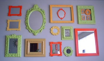 Frames and mirrors painted in bright colors give this wall a more poppy effect. Source