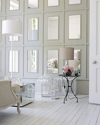 A wall of mirrored paneling is really unique, and much more formal (and permanent) than hanging mirrors. Very chic. Source