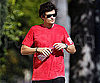 Slide Photo of Orlando Bloom Wearing a Red Shirt in LA