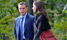 Photos of Matt Damon on the Set of The Adjustment Bureau in a Black Monogrammed Coat