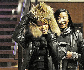 Slide Photo of Rihanna With Hood on In NYC