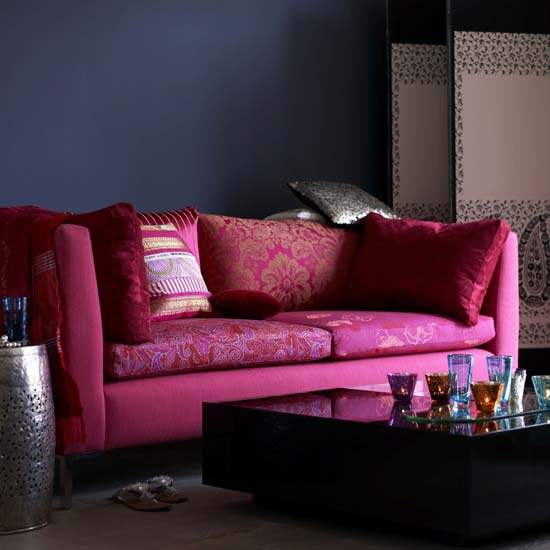 A pink sofa can look incredibly moody and thoughtful next to a dark, brooding black wall.