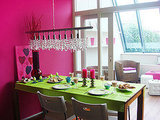 This bright pink wall looks great next to the contrasting lime green tablecloth. For a similar shade, try Sherwin Williams Feverish Pink. Source:  Flickr User koekiehaas