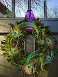 Use a green boa and peacock feathers to create this glam, girly holiday wreath. Source