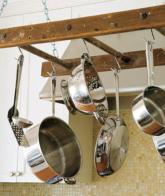 Woman's Day helps you to repurpose a creaky old ladder into a cute pot rack.