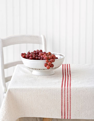 Turn an ordinary dropcloth into a charming, French country-inspired striped tablecloth, with instructions from Country Living.
