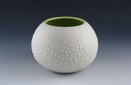 I love the round, squat shape of the Sweet Pea Vase ($40), and its cheery green interior is a fun contrast.
