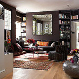 Pops of color enliven this deeply soothing brown sitting area. Source