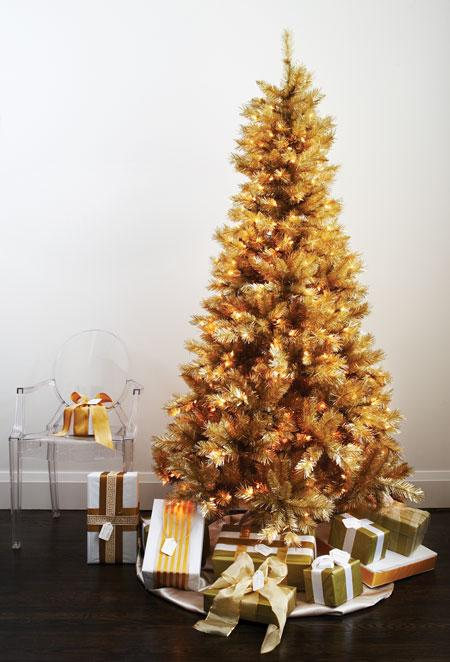 Go for the gold with a Midas-touched artificial tree. Continuing the gold palette for the ornaments makes the tree look modern and appealing instead of kitschy.  Source