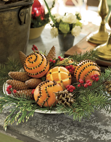 Clove and orange pomanders are always a welcome Christmas sight.  Source