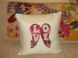 I love the '60s psychedelia of these patterned wings on the Love Pillow ($25).