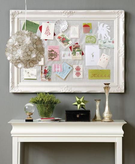 Repurpose a frame into a corkboard and use it for pinning holiday cards. Source