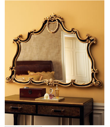 This Regency-Style Mirror ($450) captures the curves of Irene's mirror.
