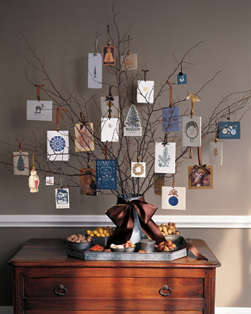Clip branches from your Winter trees and use them to hang holiday cards from ribbons. Source