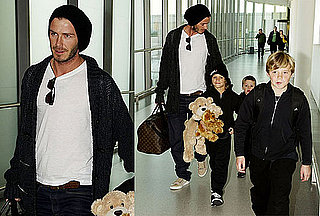 Photos of David Beckham, Romeo Beckham, Brooklyn Beckham, And Cruz Beckham at Heathrow