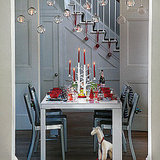 Hanging candles are a gorgeous and modern way to light a table.  Source