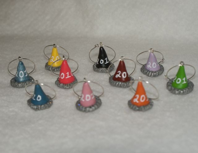 These 2010 New Year's Hat Wine Glass Charms ($20) are utterly charming.