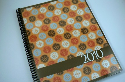 This 2010 Spiral Bound Weekly Planner ($20) is cute as a button!