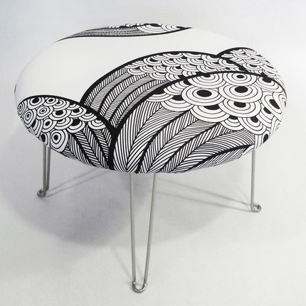 The Peacock Pouf ($250) has been recovered in a sharp, graphic black and white print, and is perfect for a side table, ottoman, or foot stool.
