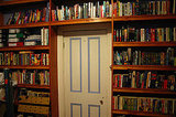 Here, an entire wall has been covered with handmade, built-in bookshelves. Source:  Flickr User Lachlan Hardy