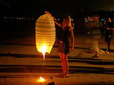 Lanterns are burnt on Chaweng Beach, Thailand, on New Year's Eve. Source:  Flickr User jetalone