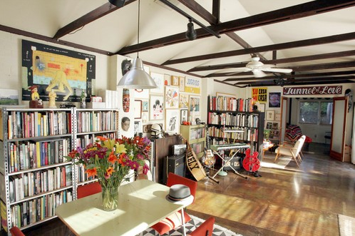 Aaron Rose's Silver Lake pad includes extensive book and media storage. Try lining an entire wall with bookshelves if you have a similar need.