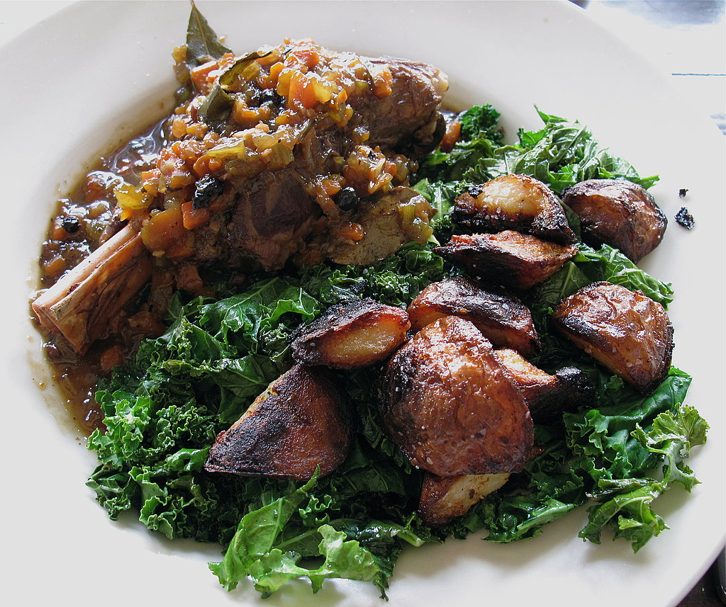 Braised Lamb Shank With Shallots, Roast Potatoes, and Sautéed Kale With Anchovies