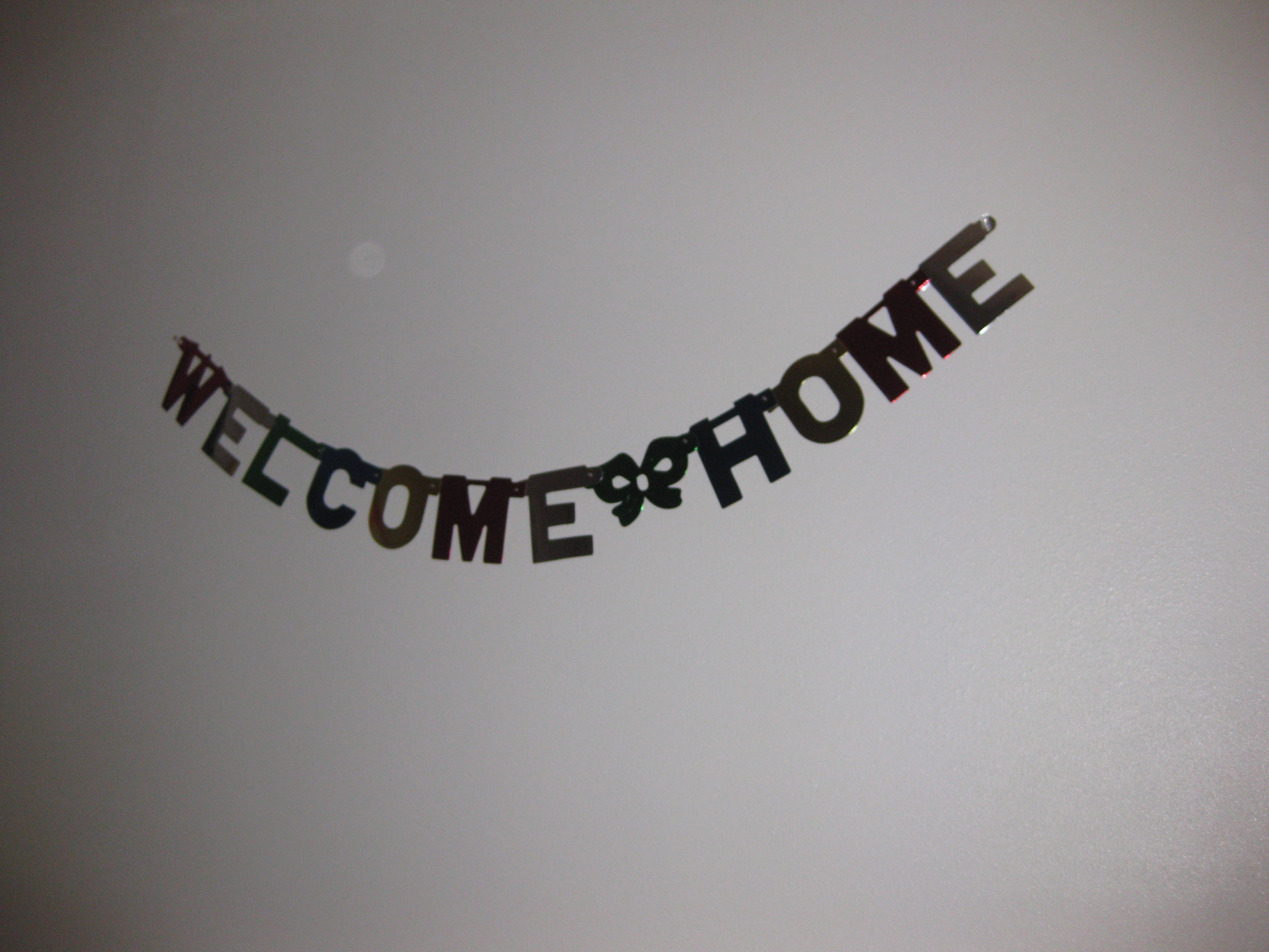 A welcome home sign hung in the kitchen.