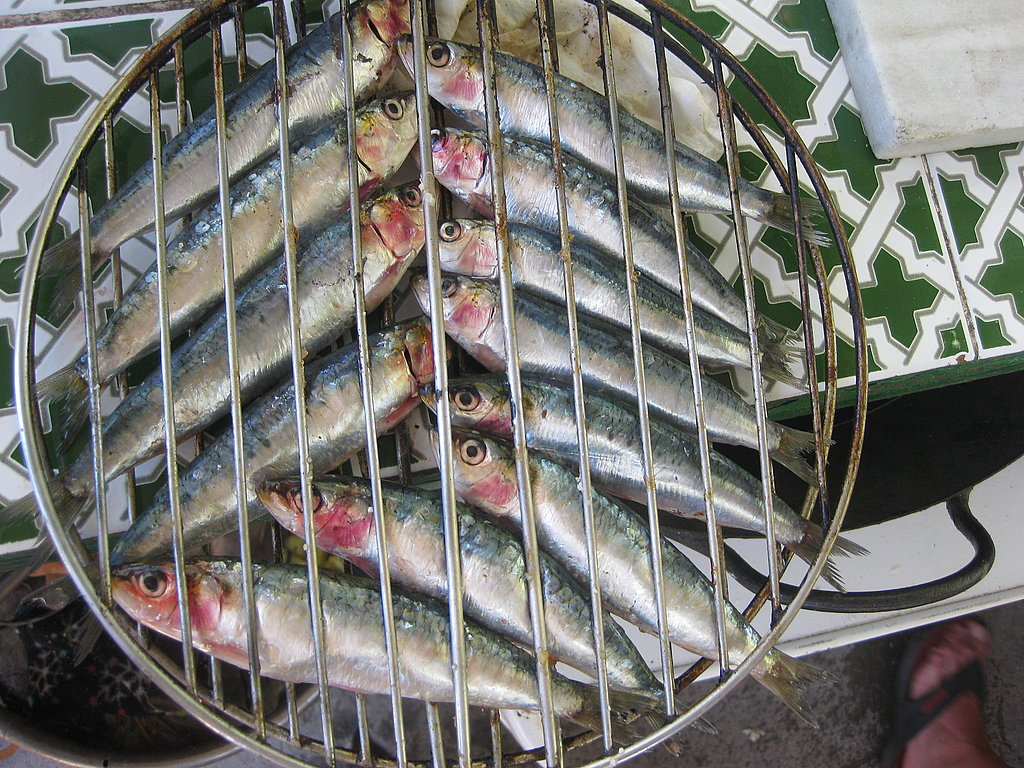 To grill the sardines, place them in a fish grilling basket. On the beaches of Malaga the sardines are grilled upright on sticks that are stuck in the sand.