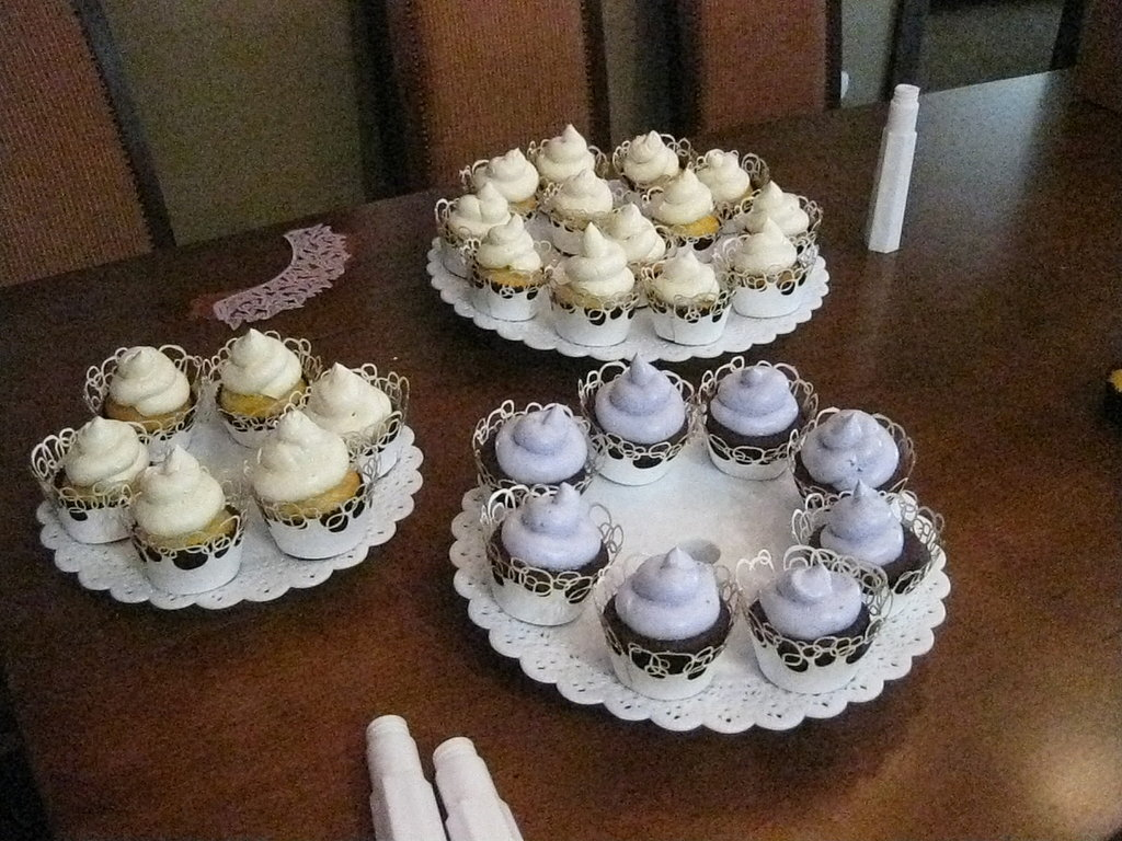 The cupcakes are ready to be transported to the reception location.