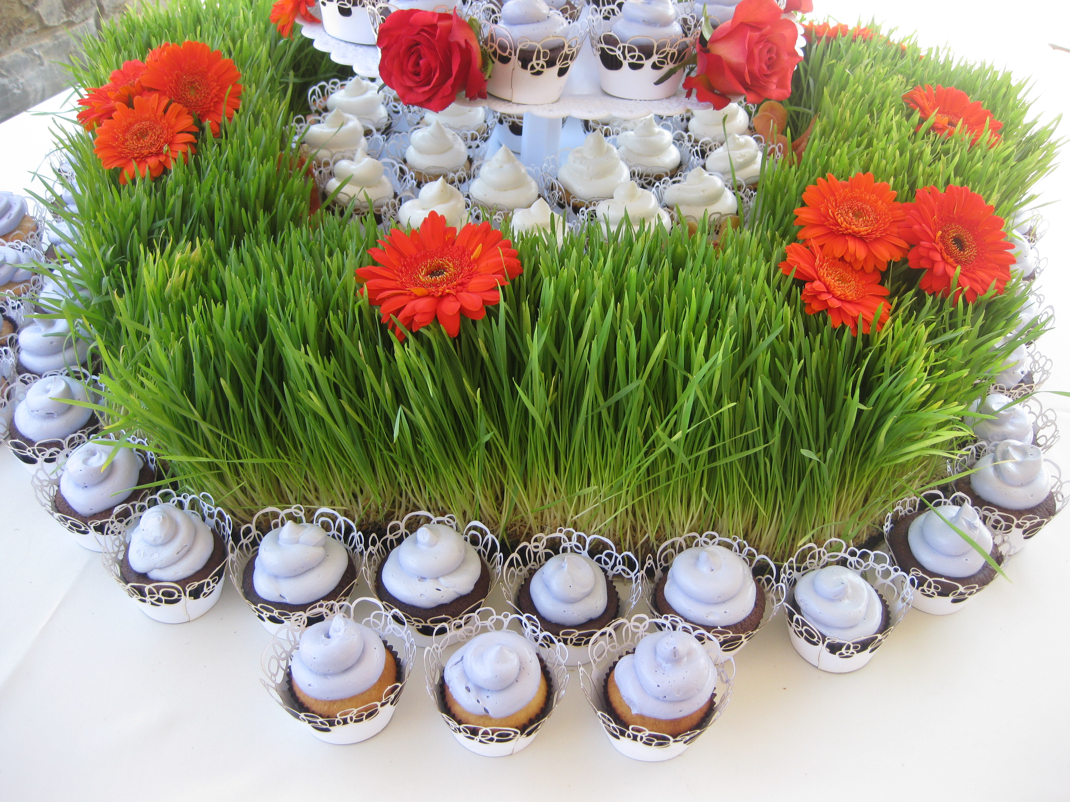 Grace decorated the wheatgrass with fresh flowers.