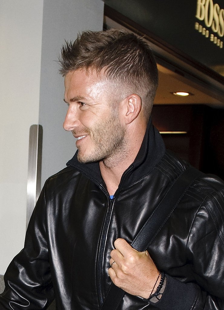 Photos of David Beckham and Brooklyn at Heathrow
