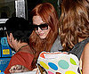 Photo Slide of Ashlee Simpson Going Through Security at LAX