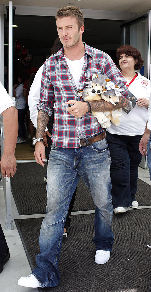 Photos of David Beckham visiting childrens hospital