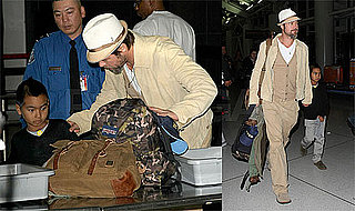 Photos of Brad Pitt and Maddox Jolie-Pitt at JFK Airport, Dave and Buster's in NYC