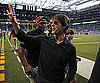 Slide Photo of Tom Cruise Waving to Fans From the Detroit Lions Field