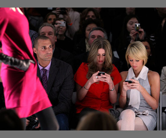 Nicky and Paris Get Caught Texting on the Runway