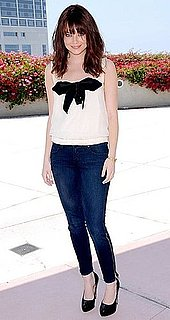 Actress Emma Stone in Zippered Jeans and Bow Blouse at Comic Con