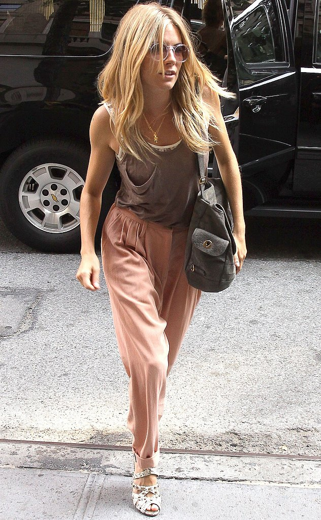 Mauve crepe pants, a light brown Kain tank, and Yves Saint Laurent bag are genius choices for a muggy day in NYC.