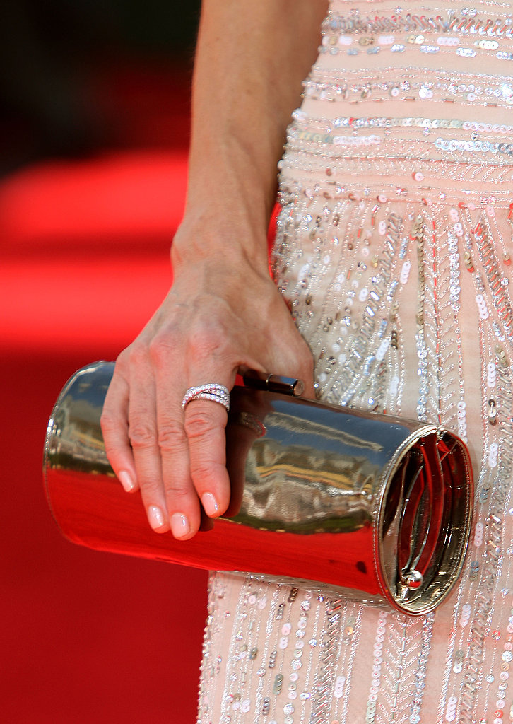 "Perrey Reeves' Jimmy Choo ""Tube"" clutch and wraparound diamond ring."