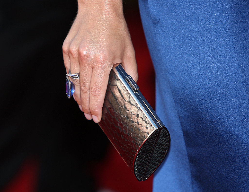 Christina Applegate's python clutch and gorgeous sapphire ring.