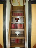 Leave the front facade of your staircase open and you'll have additional storage for books. By choosing books with beautiful bindings, you'll add color and interest to the room.