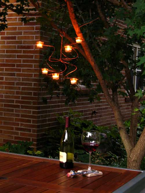 Do you like the look of this serpentine hanging light fixture? Learn how to make a similar chandelier for your back patio. It's crafted from shaped copper wire!  Source