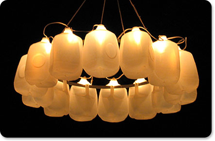 This milk jug chandelier was created with 14 milk jugs attached to a hula hoop. String lights provide the illumination.  Source