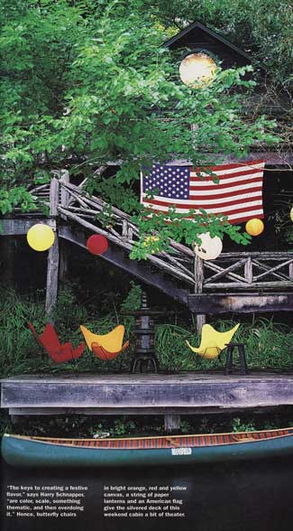 I love the way this American flag happily clashes with the orange and yellow butterfly chairs, and the green of the wood-canvas canoe.  Source
