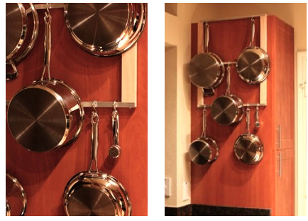 Curbly has the instructions for a cheap, simple pot rack project.