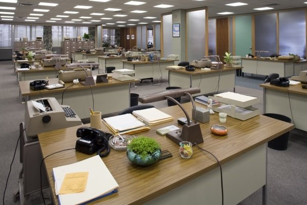 The Sterling Cooper advertising agency offices seem to buzz with activity, even when the desks are empty. I love the little touches, like the potted plants in the retro ceramic containers and the ashtrays on every desk. Source